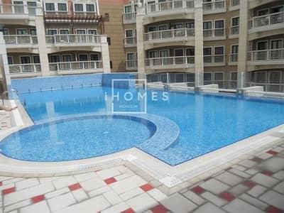 فلیٹ 1 غرفة نوم للايجار في قرية جميرا الدائرية، دبي - Stunning 1BR Fully Furnished | Massive Terrace | Pool View | JVC