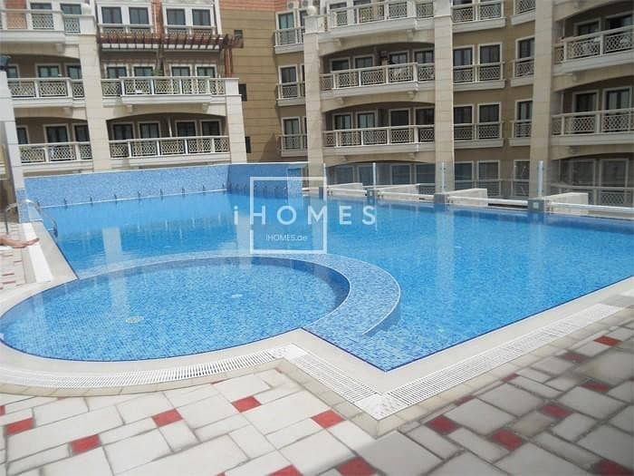 Stunning 1BR Fully Furnished   Massive Terrace   Pool View   JVC