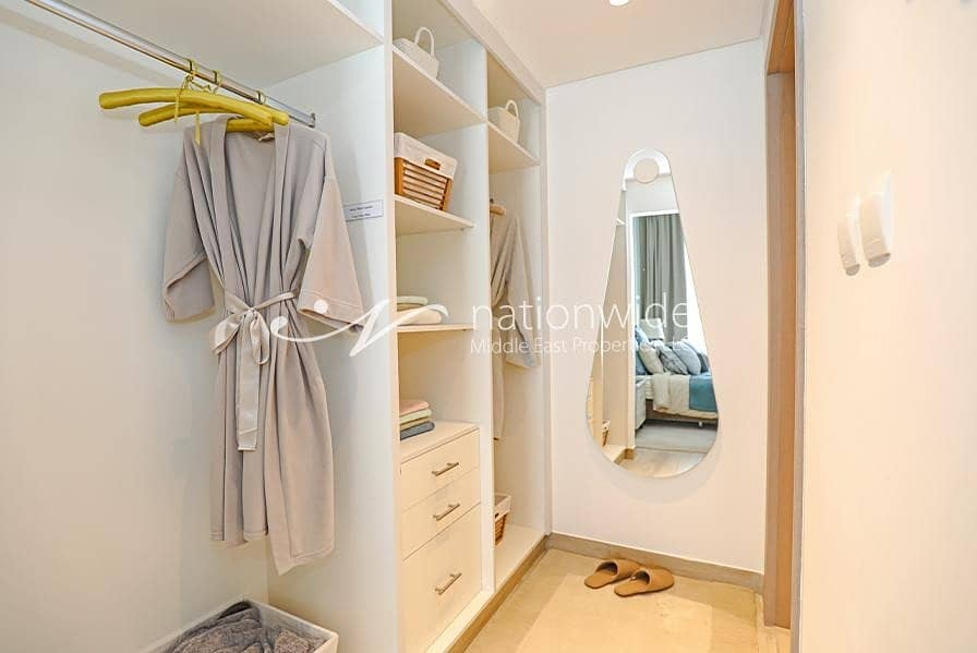 12 Invest In This Cozy Unit w/ Partial Sea View