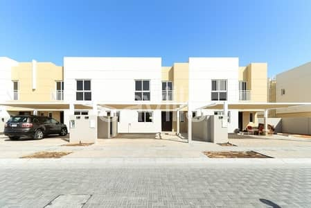 4 Bedroom Townhouse for Sale in Muwaileh, Sharjah - Single row mid unit with landscaped yard