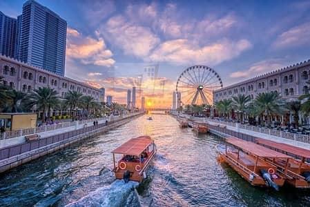 3 Bedroom Apartment for Sale in Al Qasba, Sharjah - Full view on Al Qasba Canal and Al Khan Lagoon