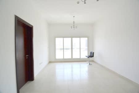فلیٹ 2 غرفة نوم للايجار في واحة دبي للسيليكون، دبي - Bright 2-br with 2/car park -balcony 1360 sqft only 51/4 chks