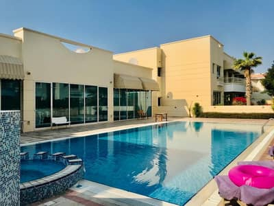 5 Bedroom Villa for Rent in Jumeirah, Dubai - Spacious 5 bedroom plus maid compound villa with pvt garden and shared pool in Jumeirha 3