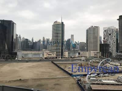 Studio for Rent in Business Bay, Dubai - BEST PRICED|LAKE VIEW|WITH BALCONY|EQUIPPED KITCHEN|