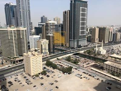 2 Bedroom Flat for Rent in Al Khan, Sharjah - For Rent in Sharjah AL Qasbaa Area Two Bedroom With Parking