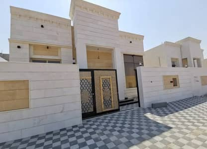4 Bedroom Villa for Sale in Al Yasmeen, Ajman - For sale at a negotiable price, a modern villa with a Syrian stone face, central air conditioning in Ajman, directly near the asphalt street, with a distinctive and unique modern design, and a very large room size with the possibility of lifetime bank fin