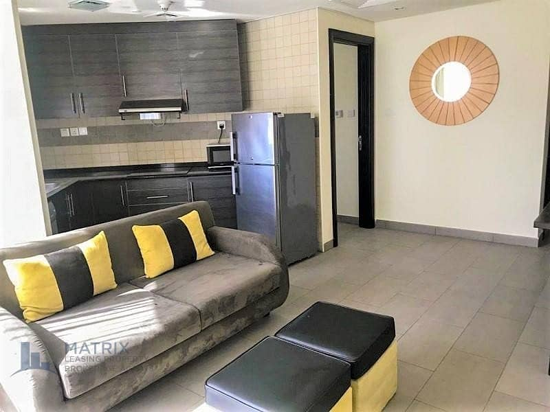 Cozy  Furnished 1 Bedroom  in the The Bridge Tower, Sports City
