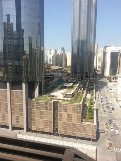 Studio for Rent in Hamdan Street, Abu Dhabi - GOOD LOCATION CLEAN AND GOOD STUDIO FLAT IN HAMDAN NEAR WTC