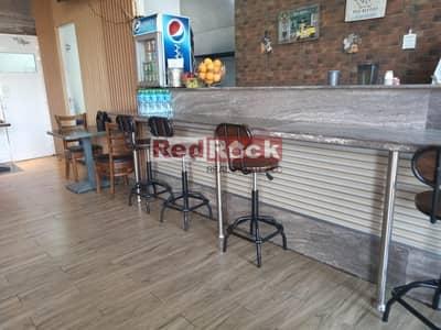محل تجاري  للايجار في بر دبي، دبي - Hot Deal Fully Operational Running Restaurant in Karama for Sale
