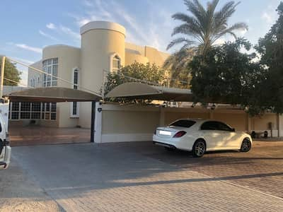 فیلا 8 غرف نوم للبيع في الطوار، دبي - لطوار -1 فيلا للبيع 8 غرف نوم فسيحة للمعيشة والطعام وغرفة الخادمة مع حديقة ناضجة