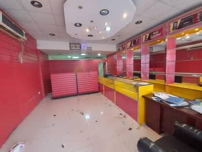 محل تجاري  للايجار في المدينة العالمية، دبي - France P-01 - Front Side - Main Road Facing - Best Location