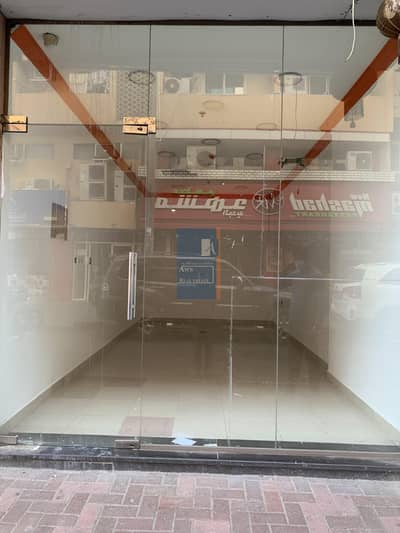 محل تجاري  للايجار في النهدة، دبي - SHOP AVAILABLE IN NEW BUILDING - AL NAHDA DUBAI-TWO MONTHS FREE