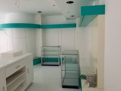 Shop for Rent in Al Khan, Sharjah - Fully Fitted G+1 Shop ( Pharmacy ) Available for Rent in Al khan Asas Tower
