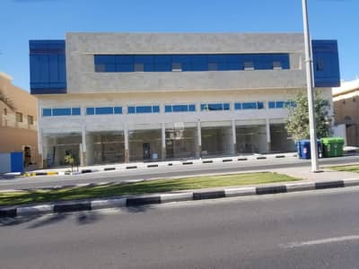 Building for Rent in Maysaloon, Sharjah - Brand New Main Road Shopping Center For rent ideal for medical center/ beauty saloon/ hypermarket