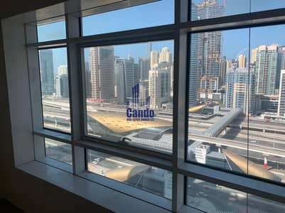 فلیٹ 1 غرفة نوم للايجار في أبراج بحيرات الجميرا، دبي - Huge Apartment / Next to DMCC Metro Station