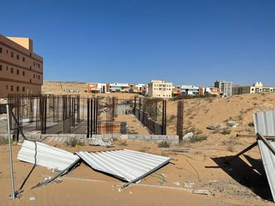 Plot for Sale in Al Jurf, Ajman - Commercial land with foundations at a cheap price
