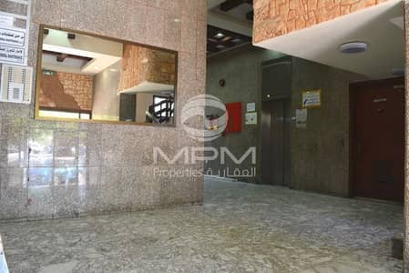 2 Bedroom Apartment for Rent in Airport Street, Abu Dhabi - 1 Month Rent Free| Central AC | Balcony | 4 Chqs