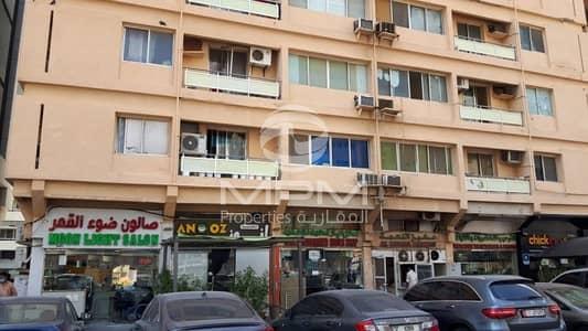 شقة 2 غرفة نوم للايجار في منطقة النادي السياحي، أبوظبي - Window A/C | Balcony | Wardrobes | 4 Chqs