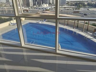 فلیٹ 2 غرفة نوم للايجار في قرية جميرا الدائرية، دبي - REEF RESIDENCE EXTRA LARGE 2HK+MAID POOL VIEW