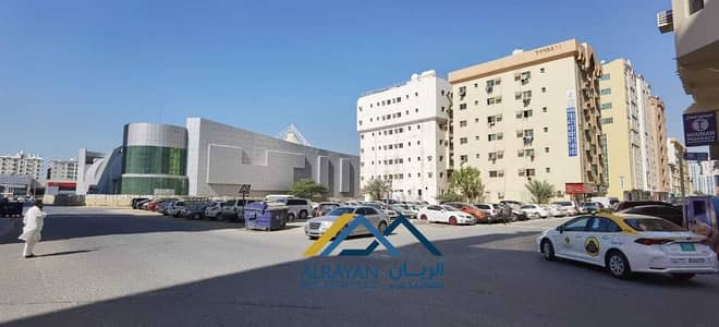 Mixed Use Land for Sale in Al Nuaimiya, Ajman - Corner land for sale, residential, commercial, G +12, excellent location