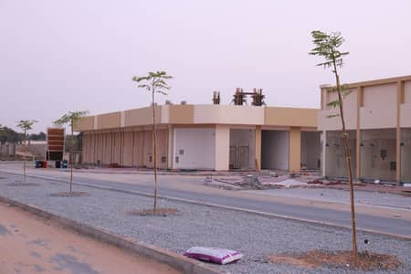 Plot for Sale in Al Zahia, Ajman - For sale commercial land in Al Zahia, an excellent strategic location for investment, on Sheikh Mohammed Bin Zayed Street, Ajman