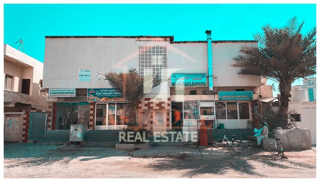 building for sale in ajman - al bustan
