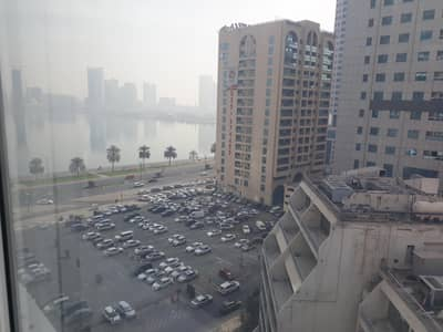 مکتب  للايجار في كورنيش البحيرة، الشارقة - Glass Partitions/Fitted/Corniche view/Low rent !!