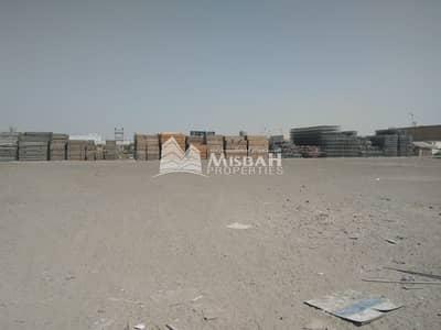 ارض تجارية  للايجار في جبل علي، دبي - Huge open land with warehouse : for commercial/ storage use