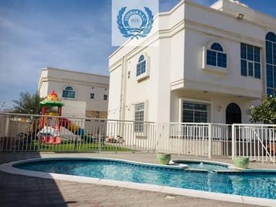 فیلا 5 غرف نوم للايجار في القوز الشارقة، الشارقة - Elegant Five Bedroom Villa With Pool And Garden