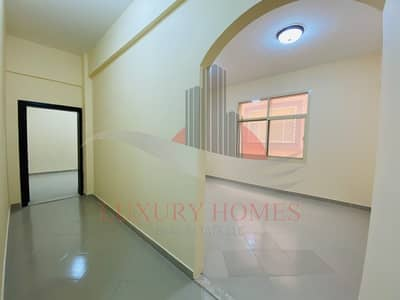 1 Bedroom Flat for Rent in Al Khabisi, Al Ain - Spacious with Elevator and Basement Parking