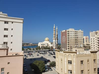 1 Bedroom Apartment for Rent in Al Mujarrah, Sharjah - CHEAPEST 1BHK CLOSE TO PARK NEAR TO CORNICH WITH CENTRAL GAS FAMILY BUILDING