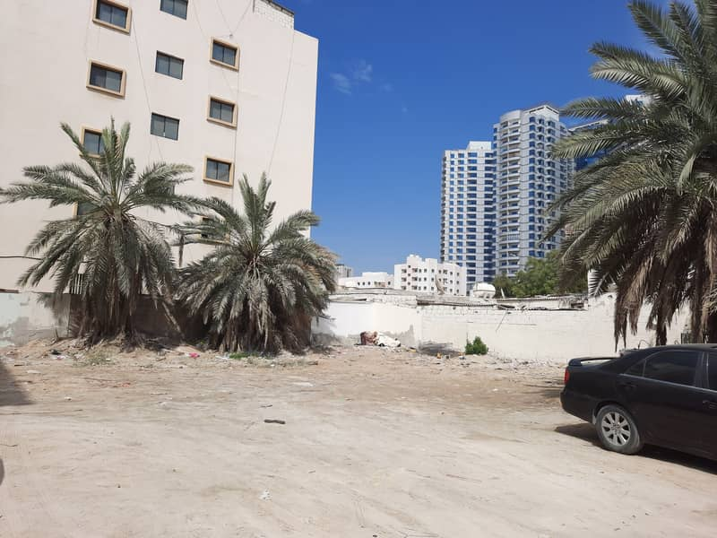 In Rashidiya2, behind Falcon Towers, land for sale, very excellent location, freehold