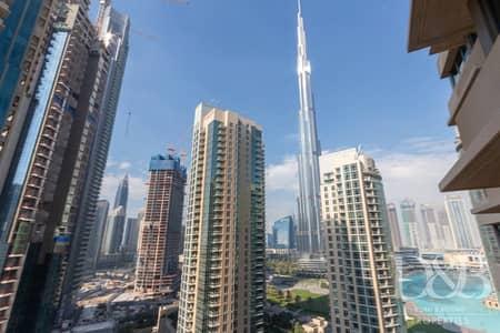 شقة 2 غرفة نوم للايجار في وسط مدينة دبي، دبي - Modern Finishes | Chiller Free | Vacant Now