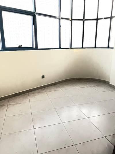 استوديو  للايجار في النهدة، الشارقة - شهر مجاني مثل استوديو المبنى الجديد مع شرفة + مطبخ منفصل فقط في 18000
