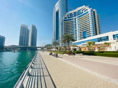 محل تجاري  للبيع في دبي مارينا، دبي - Five merged units- long facade - full marina view