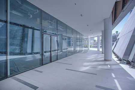 محل تجاري  للايجار في الخليج التجاري، دبي - Canal Facing | Located in a Residential Tower