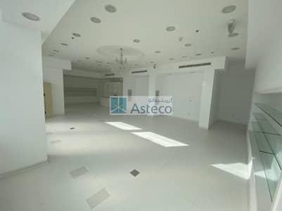 محل تجاري  للايجار في موتور سيتي، دبي - Prime Location I AED 150 psf I 4 Months Free