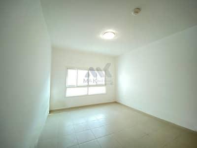 شقة 2 غرفة نوم للايجار في الكرامة، دبي - شقة في بناية همسة A الكرامة 2 غرف 70000 درهم - 5013554