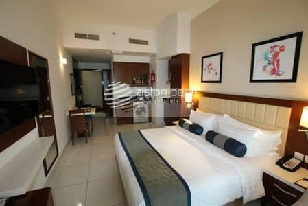 شقة فندقية  للبيع في مدينة دبي الرياضية، دبي - Fully Furnished Studio |Lake View |Modern Building