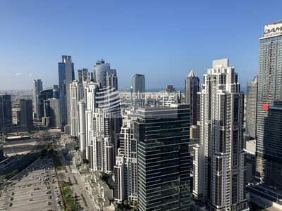 شقة 1 غرفة نوم للايجار في وسط مدينة دبي، دبي - Pool View | Bright and Spacious| Chiller Free |1BR