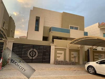 5 Bedroom Villa for Rent in Al Mowaihat, Ajman - Luxurious villa for rent with air conditioners, excellent Arabic finishing, on the asphalt street directly, new