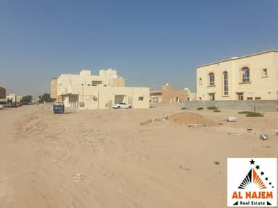 Plot for Sale in Al Rawda, Ajman - Sale of residential commercial land at a nominal price in Al Rawda 2 on both streets