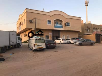 Building for Sale in Al Mowaihat, Ajman - For sale a building in Ajman, Al Mowaihat 2, located on the corner of two streets, a very excellent location