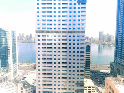 1 Bedroom Apartment for Rent in Corniche Al Buhaira, Sharjah - Ac Free Luxury 1BR Apartment with Water View Master Bedroom and Health Club