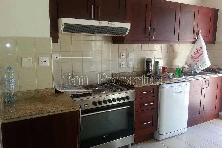 4 Nicely located 2 bedroom town house plus maids.