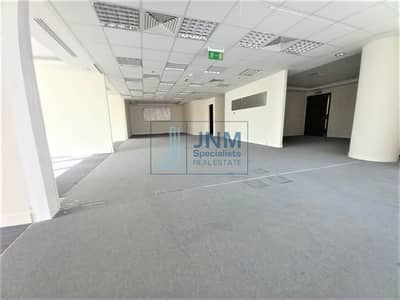 Office for Sale in Motor City, Dubai - Fitted and Partitioned Office Space | Lower Floor