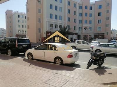 محل تجاري  للايجار في المدينة العالمية، دبي - READY SHOP AVAILABLE IN ENGLAND CLUSTER IS FOR RENT AED 22000/-Yearly
