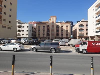 ارض تجارية  للبيع في النعيمية، عجمان - ارض سكني تجاري مساحة 600 متر شارعين وسكتين بجانب مدرسة الحكمة