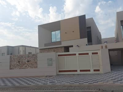 5 Bedroom Villa for Sale in Al Mowaihat, Ajman - Owns your own villa for you and your family in Ajman, Al Rawda area, modern design Super Deluxe with the possibility of easy bank financing