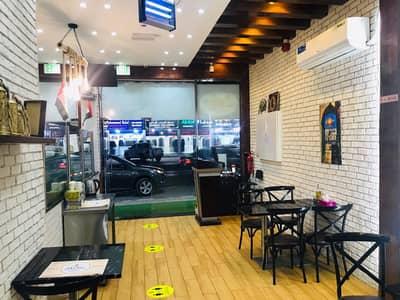 محل تجاري  للبيع في الروضة، عجمان - *فرصه كبيره للاستثمار علي شارع الشيخ عمار بدخل ثابت ومربح *